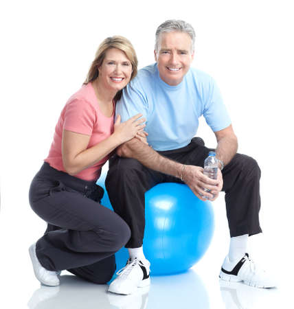 healthy seniors: Gym & Fitness. Smiling elderly couple working out. Isolated over white background