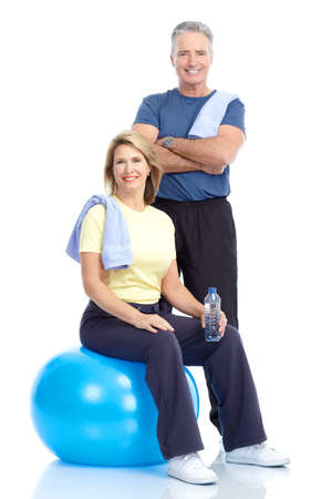 Gym & Fitness. Smiling elderly couple working out. Isolated over white background Stock Photo - 8538341