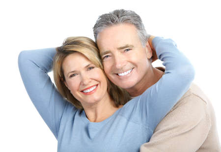 Happy seniors couple in love. Healthy teeth. Isolated over white background Stock Photo - 8555078