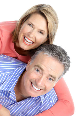 Happy seniors couple in love. Healthy teeth. Isolated over white background Stock Photo - 8555075