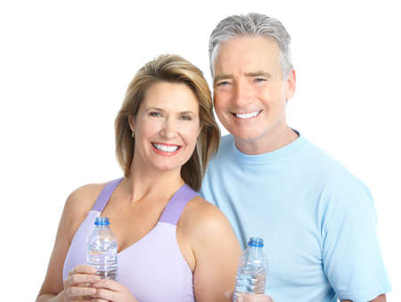 Gym & Fitness. Smiling elderly couple working out. Isolated over white background  photo