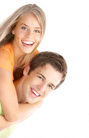 dental smile: Happy smiling couple in love. Over white background