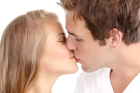 Happy kissing couple in love. Over white background