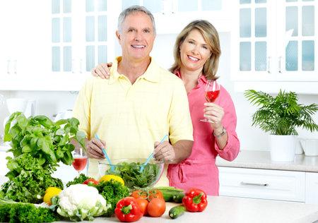Happy seniors couple cooking at kitchen  photo