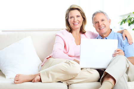 pensioner: Senior couple  working with laptop at home