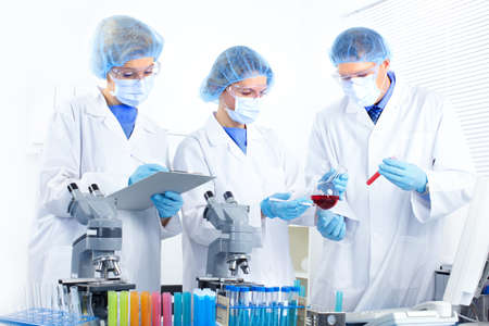 Science team working with microscopes at  laboratory Stock Photo - 8554972