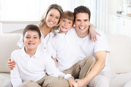family sofa: Happy family. Father, mother and children at home