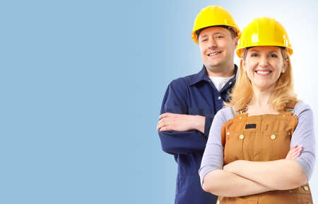 Contractor people  in yellow uniform. Over blue background  photo
