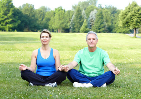 Happy elderly senior couple doing yoga  photo