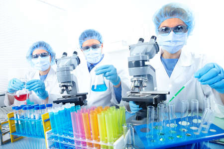 Science team working with microscopes at  laboratory Stock Photo - 8555049