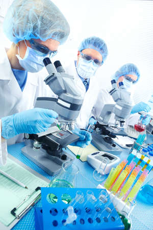 laboratory technician: Science team working with microscopes at  laboratory  Stock Photo