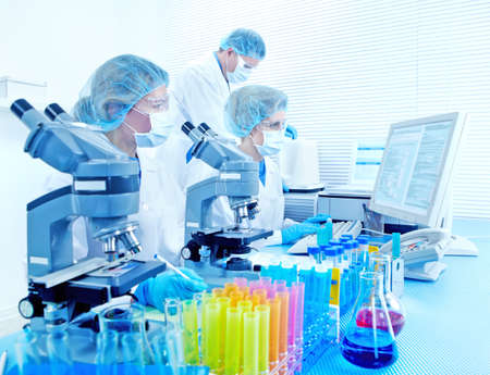 Science team working with microscopes at  laboratory Stock Photo - 8554958