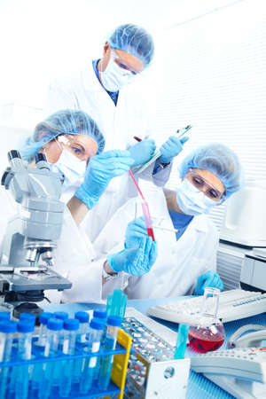 Science team working with microscopes at  laboratory Stock Photo - 8555016