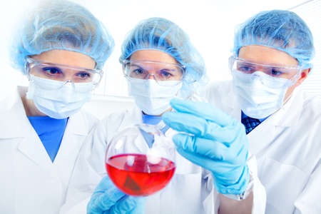 Science team working with test tubes at  laboratory Stock Photo - 8555029