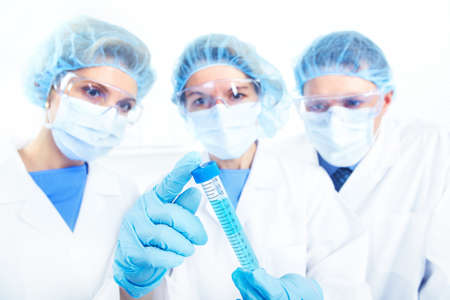 laboratorian: Science team working with test tubes at  laboratory  Stock Photo