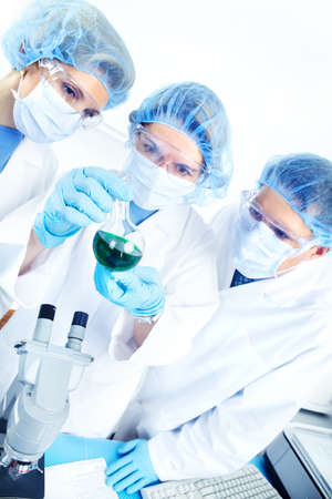 Science team working with microscopes at  laboratory  Stock Photo