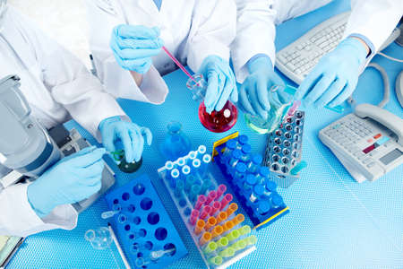 Science team working with test tubes at  laboratory Stock Photo - 8555110