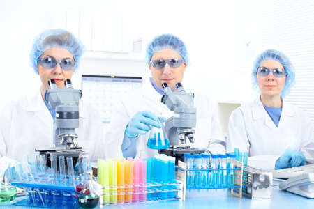 Science team working with microscopes at  laboratory Stock Photo - 8554965