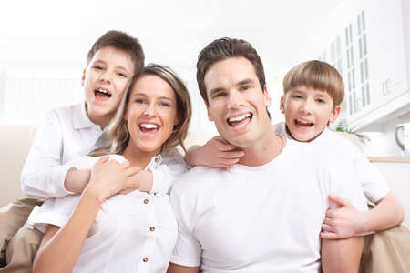 Happy family. Father, mother and children at home Reklamní fotografie