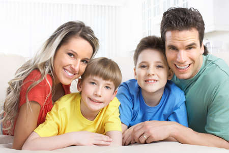 Happy family. Father, mother and children at home Stock Photo - 8555004