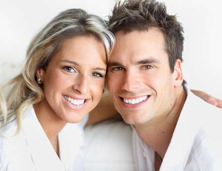 Happy smiling couple in love. Over white background  photo