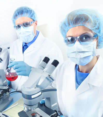 Science team working with microscopes at  laboratory Stock Photo - 8591730