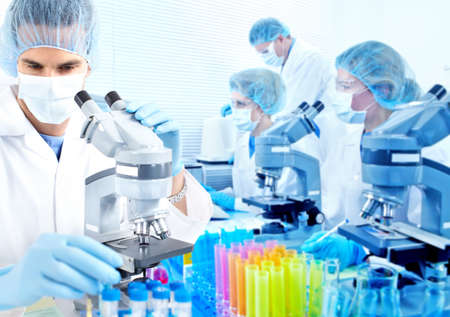 equipment: Science team working with microscopes at  laboratory  Stock Photo