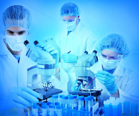 medical assistant: Science team working with microscopes at  laboratory  Stock Photo