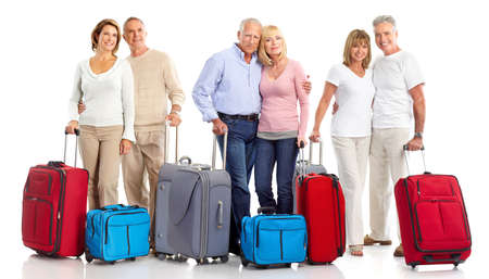 city trip: Senior couple travelers with bags. Isolated over white background