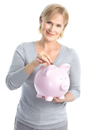 Woman with a pig bank. Isolated over white background Stock Photo - 8605365