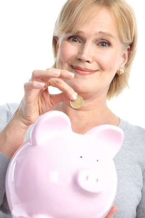 Woman with a pig bank. Isolated over white background Stock Photo - 8605387
