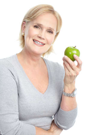 mature woman face: Mature smiling woman with a green apple