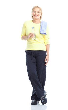 exercitation: Gym & Fitness. Smiling elderly woman. Isolated over white background  Stock Photo