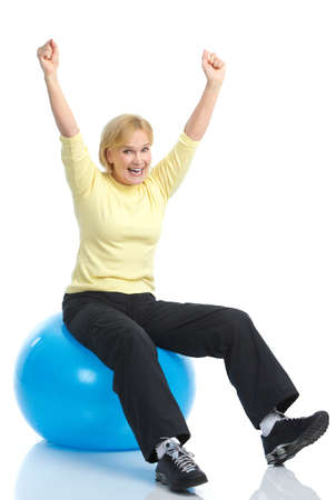 Gym & Fitness. Smiling elderly woman working out. Isolated over white background Stock Photo - 8616885