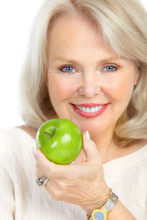 Mature smiling Woman with a green apple Standard-Bild - 8616930