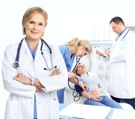health insurance: Medical doctors and a woman patient.  Stock Photo