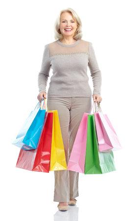 shopper: Shopping happy  elderly woman. Isolated over white background  Stock Photo
