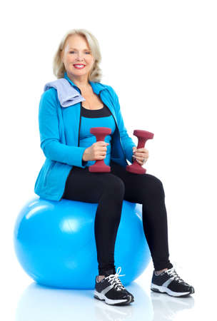 exercitation: Gym & Fitness. Smiling elderly woman working out. Isolated over white background