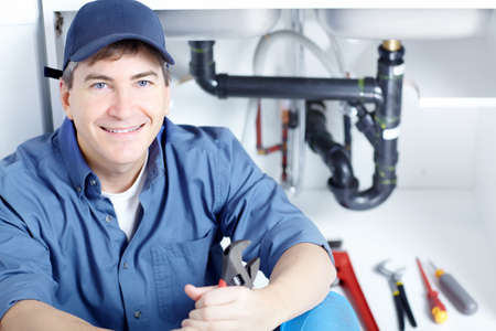 Mature plumber fixing a sink at kitchen Stock Photo - 8617056