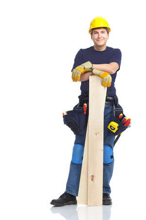 Handsome builder with wood planks. Isolated over white background Stock Photo - 8616946