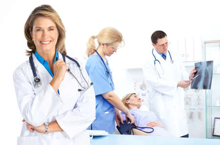 patients: Medical doctors and a woman patient.  Stock Photo