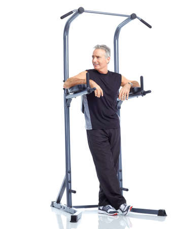 exercitation: Gym & Fitness. Smiling elderly man  working out. Isolated over white background  Stock Photo