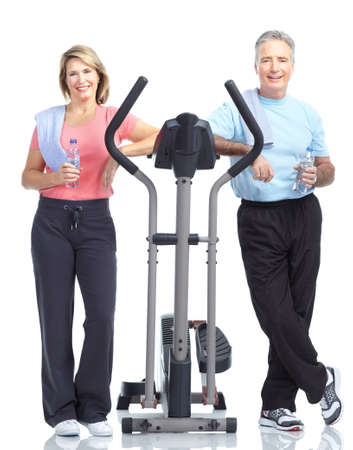 exercitation: Gym & Fitness. Smiling elderly couple working out. Isolated over white background