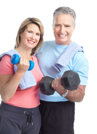 Gym & Fitness. Smiling elderly couple with dumbbells. Isolated over white background