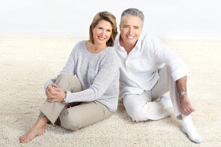 Happy elderly seniors couple at home Stock Photo - 8678904
