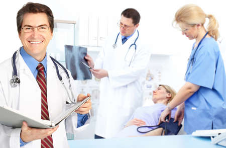 Medical doctors and a woman patient.  Stock Photo