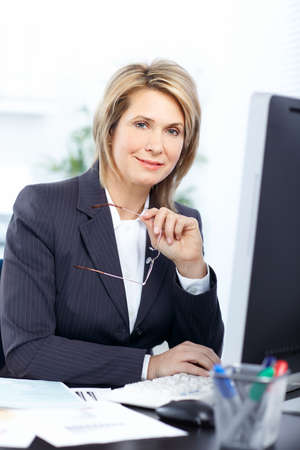 Pretty business woman working at office photo