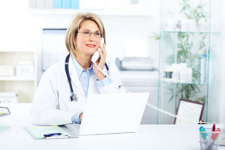 Medical doctor woman in the office  photo