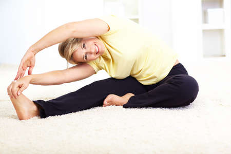 Happy mature woman doing yoga  photo