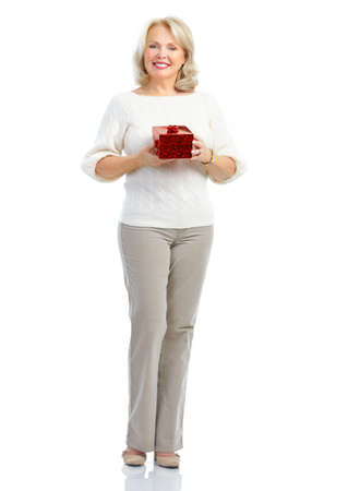 Happy  mature woman with a gift. Isolated over white background photo